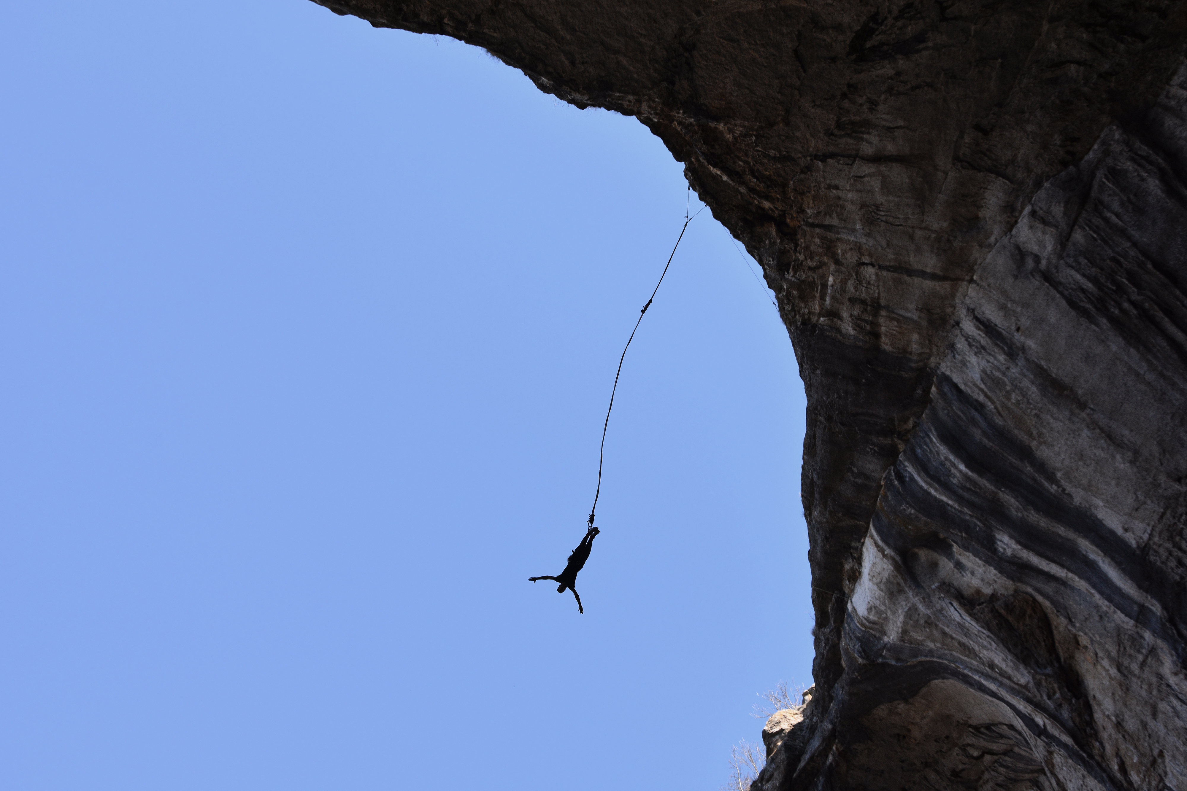 Bungee jump in Pohodna Cave, Bulgaria